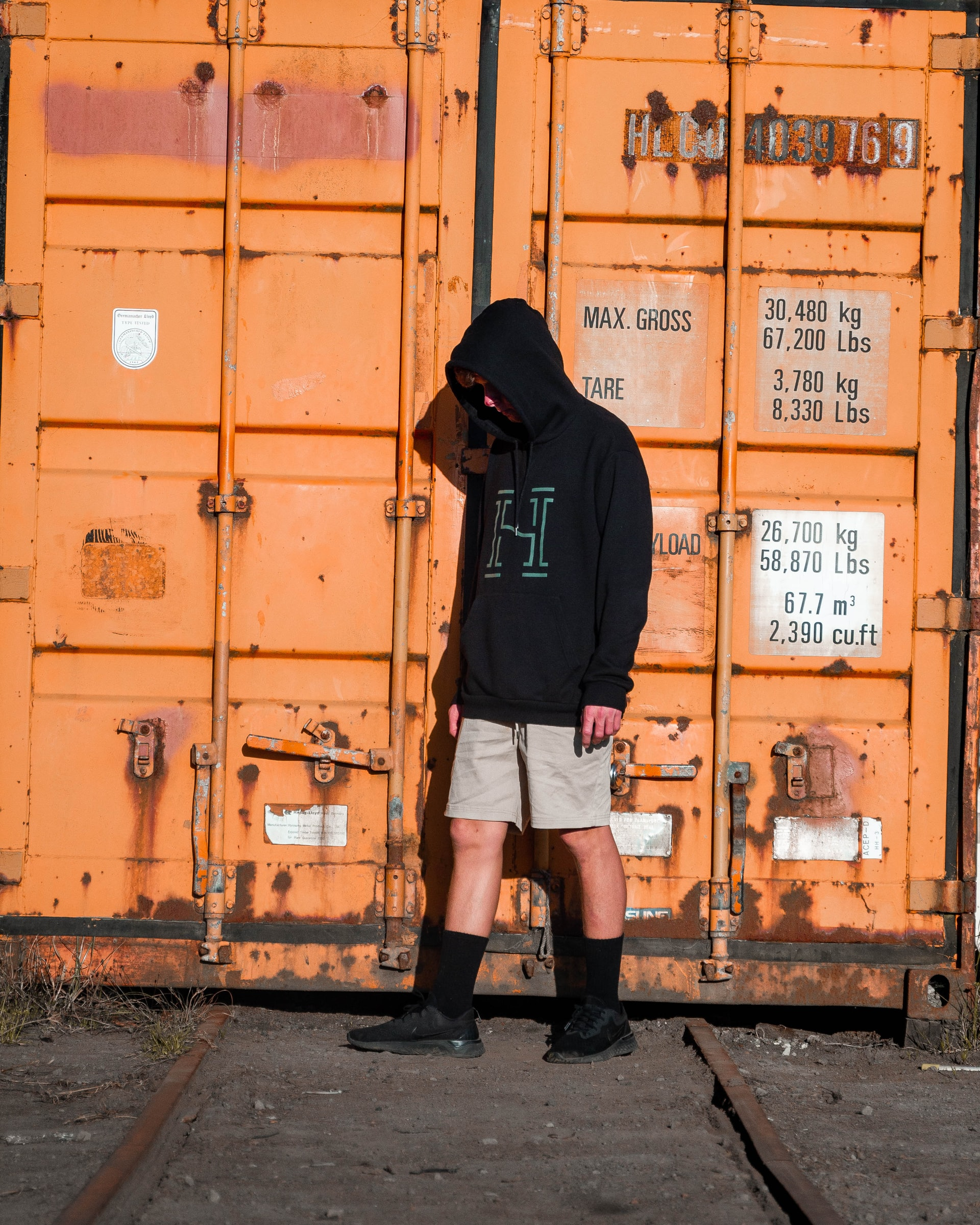A man near a shipping container
